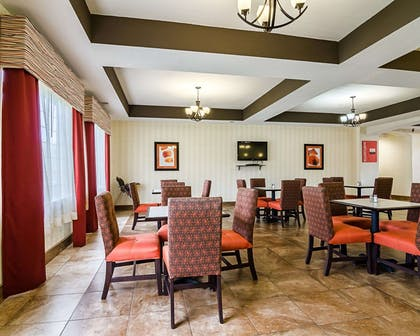 Enjoy breakfast in this seating area | Comfort Inn & Suites Lawrence - University Area