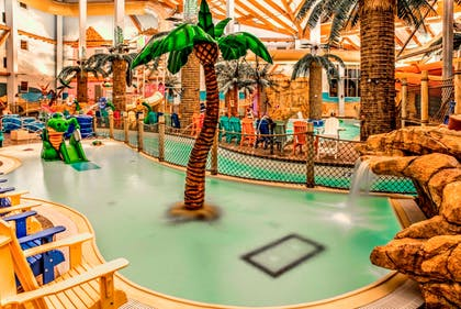Hotel's indoor water park | The Heritage Inn & Suites, an Ascend Hotel Collection Member