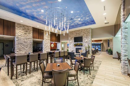 Spacious lobby with sitting area | The Heritage Inn & Suites, an Ascend Hotel Collection Member