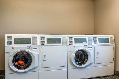 Guest laundry facilities | The Heritage Inn & Suites, an Ascend Hotel Collection Member