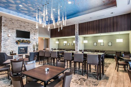 Enjoy breakfast in this seating area | The Heritage Inn & Suites, an Ascend Hotel Collection Member