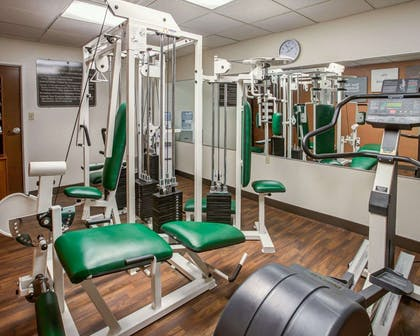 Fitness center with cardio equipment and weights | Comfort Suites