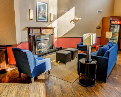 Lobby with fireplace | Comfort Suites