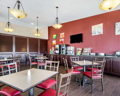 Enjoy breakfast in this seating area   Quality Inn & Suites