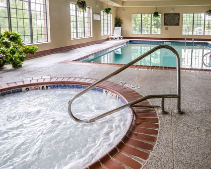 Relax in the hot tub | Comfort Suites