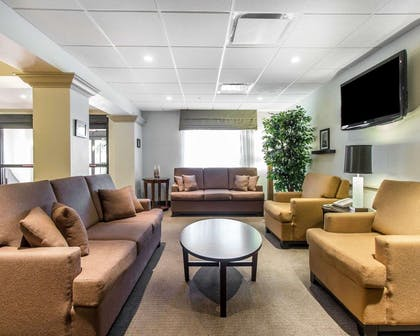 Spacious lobby with sitting area | Sleep Inn & Suites