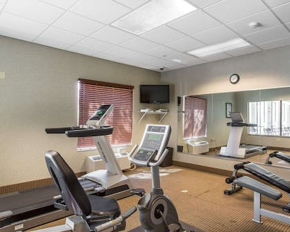 Exercise room with cardio equipment and weights | Comfort Inn And Suites