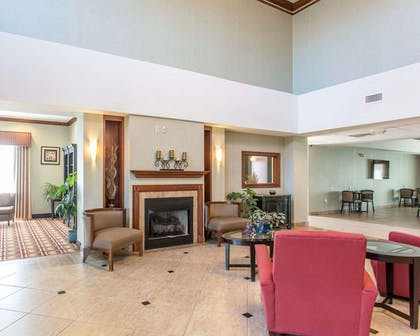 Relax by the fireplace in the lobby | Comfort Inn And Suites