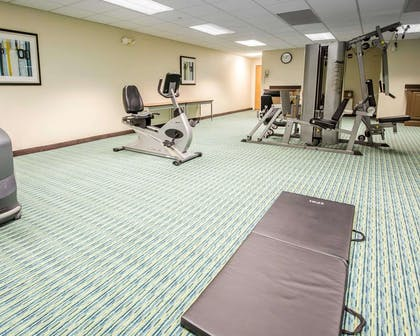 Exercise room with cardio equipment and weights | Comfort Inn Shepherdsville - Louisville South
