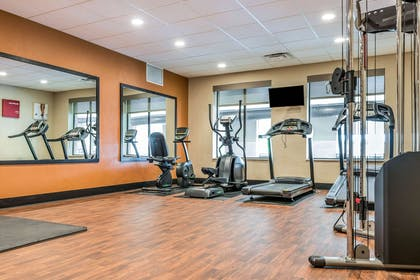 Exercise room with cardio equipment and weights | Comfort Suites Florence - Cincinnati South