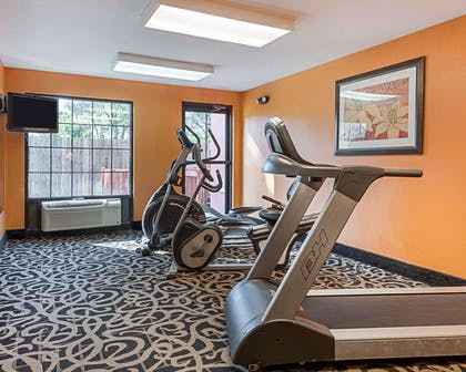 Fitness center with television | Quality Suites