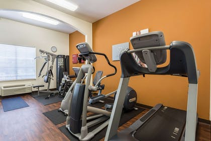 Exercise room with cardio equipment | Comfort Suites