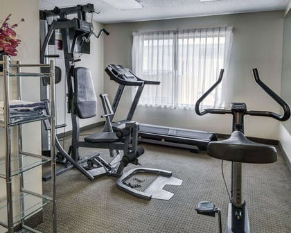 Exercise room with cardio equipment and weights | Quality Suites Baton Rouge East - Denham Springs