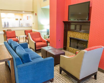 Spacious lobby with sitting area | Comfort Suites Port Allen