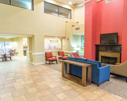 Relax by the fireplace in the lobby | Comfort Suites Port Allen