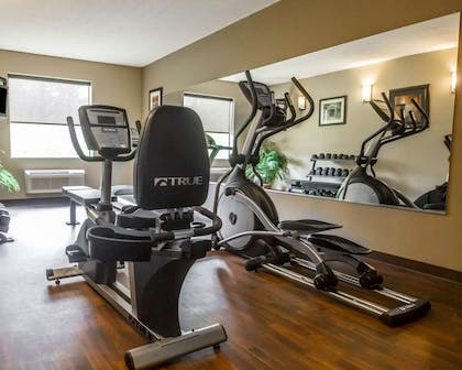Exercise room with cardio equipment and weights | Comfort Inn Amite