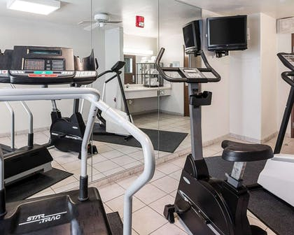 Exercise room with television | Quality Inn And Suites