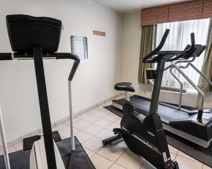 Exercise room with cardio equipment | Quality Inn And Suites