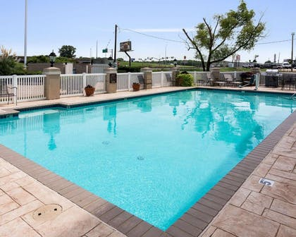 Outdoor pool with sundeck | Quality Inn And Suites