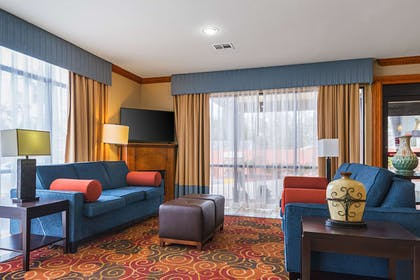 Spacious lobby with sitting area   Comfort Suites Lake Charles