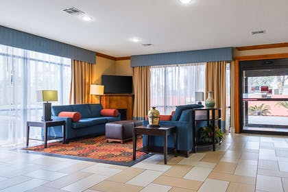 Spacious lobby with sitting area | Comfort Suites Lake Charles