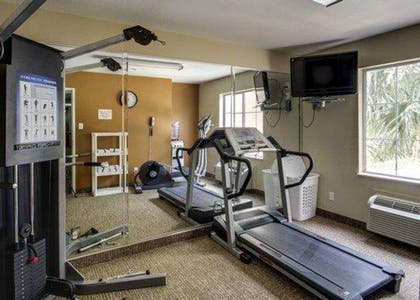 Fitness center with cardio equipment and weights | Comfort Inn & Suites Morgan City