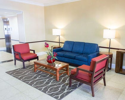 Spacious lobby with sitting area | Comfort Inn New Orleans Airport