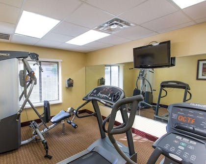 Fitness center with cardio equipment and weights | Comfort Inn New Orleans Airport