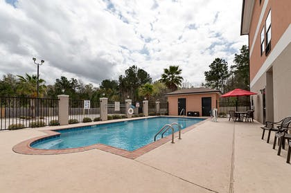 Relax by the pool | Comfort Suites Sulphur