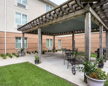 Relax on the hotel patio | MainStay Suites Houma