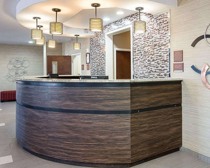 Modern front desk with a helpful and friendly staff | Comfort Suites