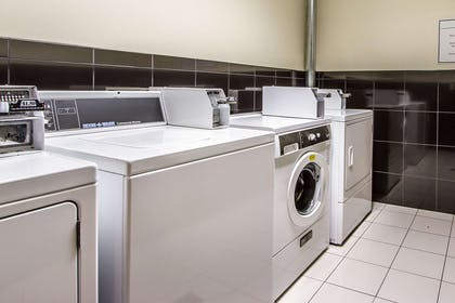 Guest laundry facilities | Evangeline Downs Hotel, an Ascend Hotel Collection Member