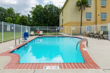 Relax by the pool | Comfort Inn And Suites