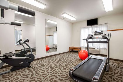 Exercise room with television | Quality Inn & Suites Federal Way - Seattle