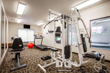 Exercise room with cardio equipment and weights | Quality Inn & Suites Federal Way - Seattle