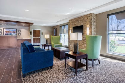 Spacious lobby with sitting area | Comfort Inn & Suites at CrossPlex Village