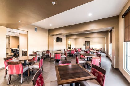 Enjoy breakfast in this seating area | Comfort Suites Grand Prairie - Arlington North