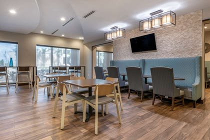 Enjoy breakfast in this seating area | Comfort Suites Fort Lauderdale Airport & Cruise Port
