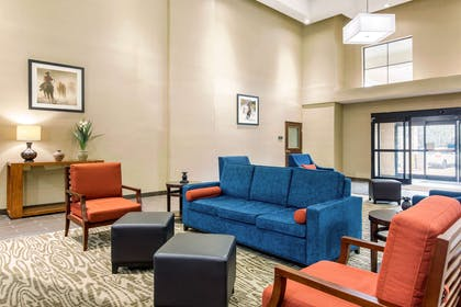 Spacious lobby with sitting area | Comfort Inn & Suites IAH Bush Airport – East