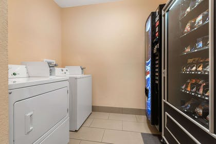 Laundry and vending area | Quality Inn & Suites