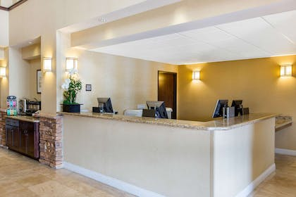 Front desk with friendly staff | The Oaks Hotel & Suites, an Ascend Hotel Collection Member