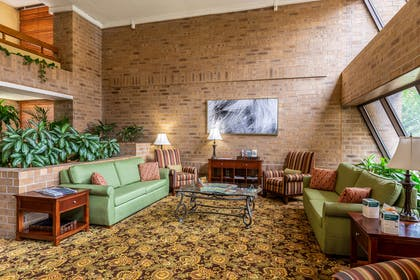 Spacious lobby with sitting area | Clarion Inn & Suites Central I-44