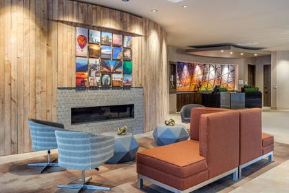 Spacious lobby with sitting area | Cambria Hotel Omaha Downtown