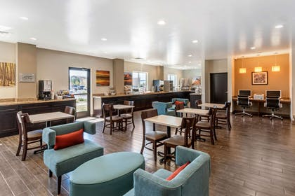 Enjoy breakfast in this seating area | Sleep Inn & Suites Denver International Airport