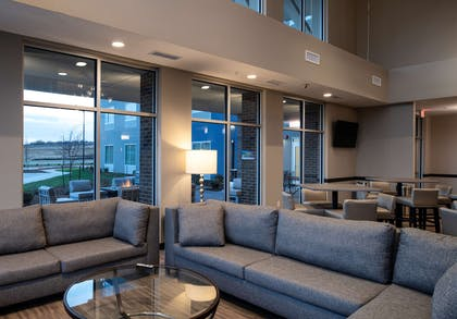 Relax in our spacious lounge area | Best Western Plus West Lawrence