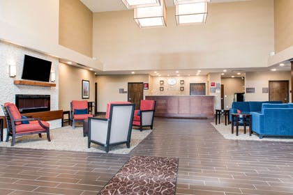 Spacious lobby with sitting area   Comfort Suites Columbus Airport
