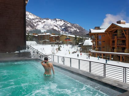 Hotel Terra Pool at Winter with Tram and People | Hotel Terra Jackson Hole - A Noble House Resort
