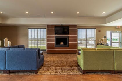 Spacious lobby with sitting area | Comfort Inn & Suites – Harrisburg Airport – Hershey South