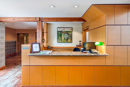 Front desk with friendly staff | Inn at Port Gardner, an Ascend Hotel Collection Member