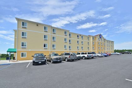 exterior | Amelia Extended Stay & Hotel